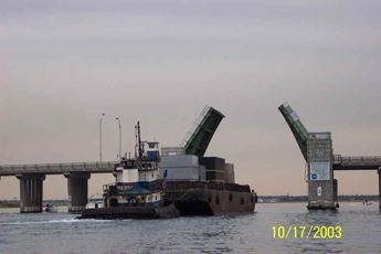 Turbine on its way to Power Plant 2 by barge